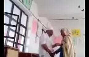 A 70 yrs procreate sex snivel in contrast with 30 yrs bold lassie in classroom.